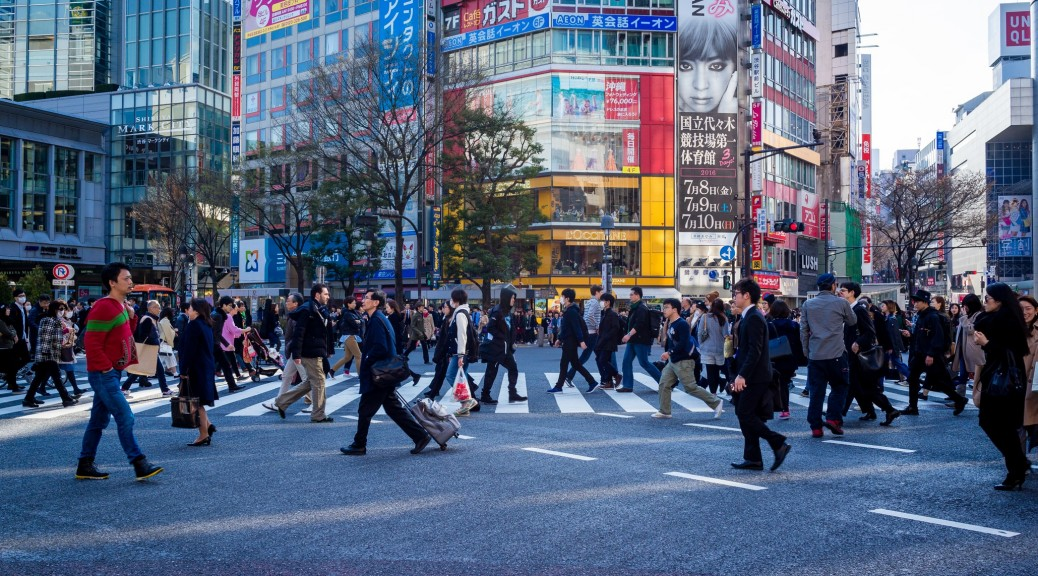 A busy street in Tokyo with localised marketing messages in the background